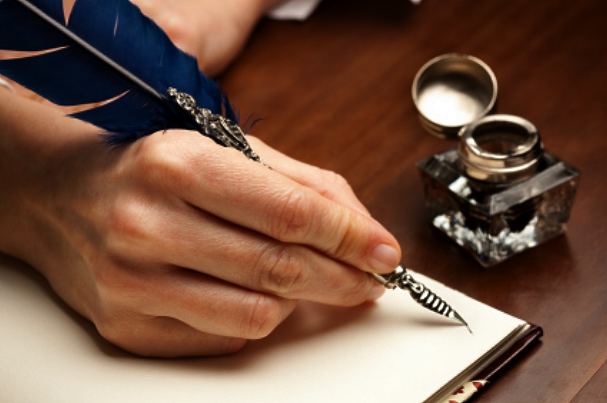 quill-pen-diary-writing-ink-well-womans-hand